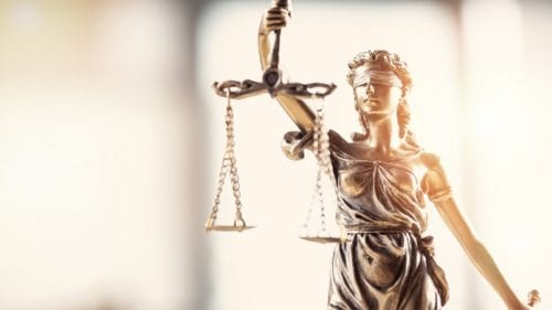 Lady Justice with Scales of Justice Stock Photo